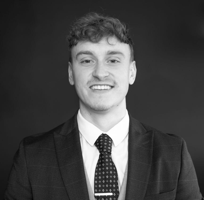 Headshot of Alex Mook, Wealth Advisor for Whiskey & Wealth Club