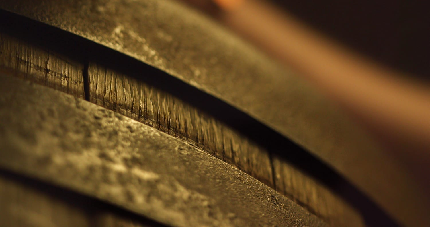 Close up still of a whiskey cask.